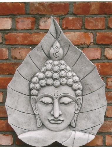 Boeddha hoofd in blad